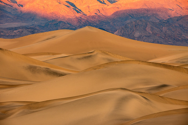 While photographing the sand dunes on our second morning, I couldn't help but notice how the sun was dropping down on the mountains behind these dunes ... so I fired a few shots!