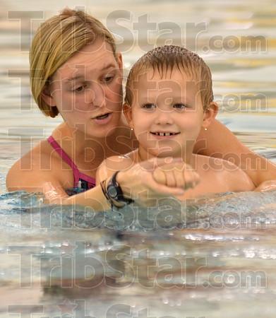MET120916 swim marietta harney