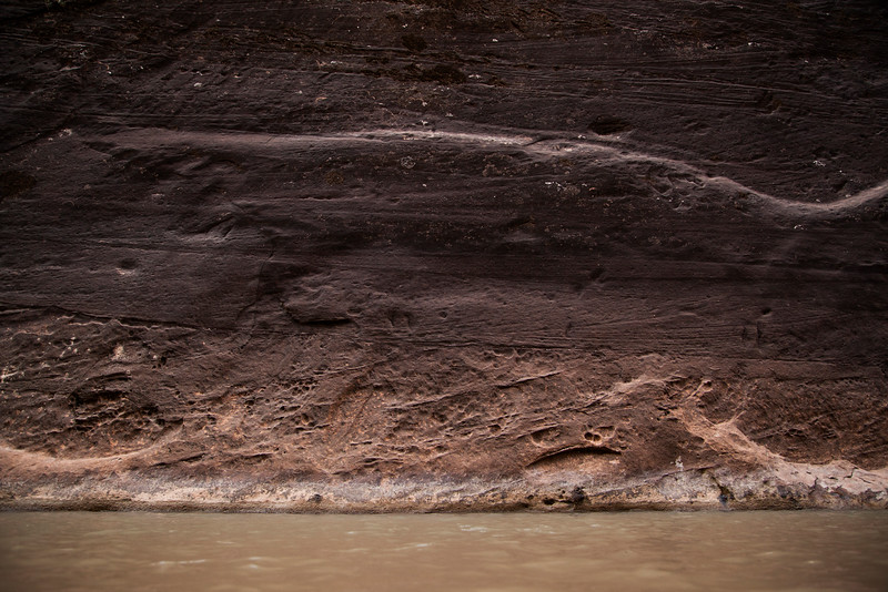 Sandstone walls show the wear of centuries in Zion's narrows.