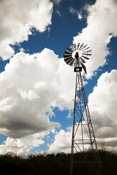 A windmill powers a pump in the deserts of Sonora, Mexico.