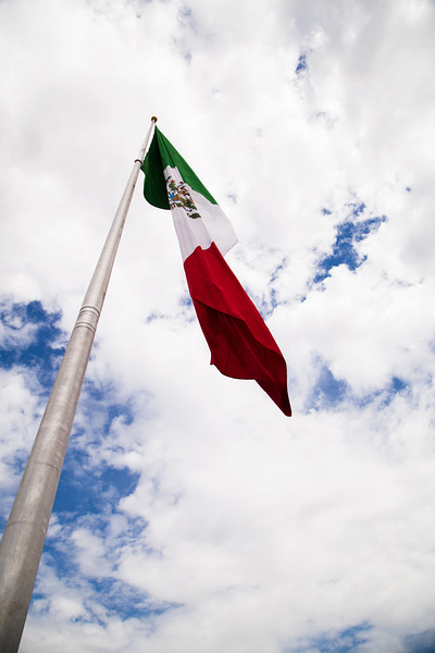 A giant Mexican flag stands high atop the Cerro Campaña viewpoint.