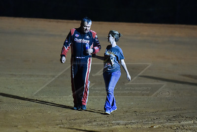 Randy Weaver walking back with Alexis Thomas after his wreck