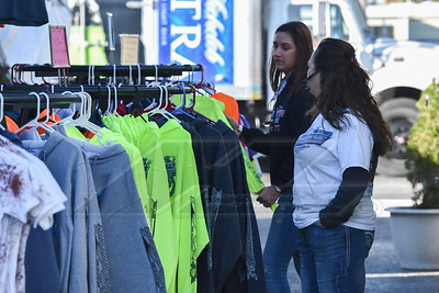Fans shopping on souvenir row