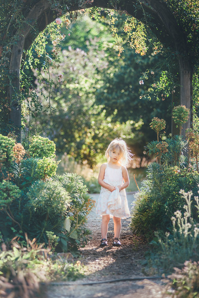 Elena found an amazing little garden walkway to place Shane's daughter. I Loved the light here!