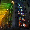 The stained glasswork of Basilica de la Sagrada Família reflects and refracts off the stone pillars in astounding ways. Barcelona, Spain.