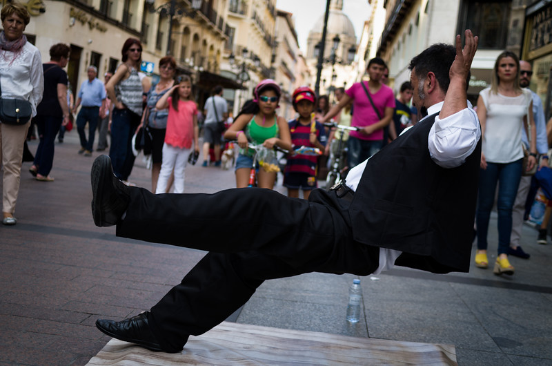 A street performer captivates an impromptu audience. Zaragoza, Spain.