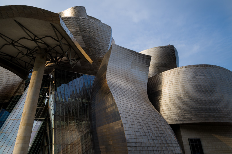 The outside of el Museo Guggenheim is skinned in titanium for its reflective qualities & its durability. Bilbao, Spain.