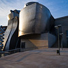 The 1997 opening of el Museo Guggenheim marked a stark transformation from industrial port town to bohemian art & tourist mecca and was not without controversy. Bilbao, Spain.
