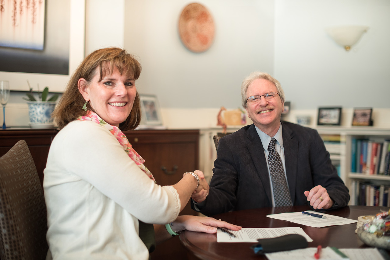 President Kim Cassidy meets with Haverford's President Kim Benston to sign the Bi-Co Agreement.
