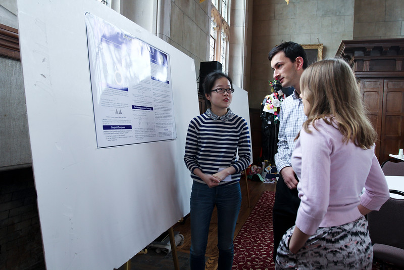 At the poster session persistent topologist Paula Sun  '16 describes her work on Data and Simplicial Homology.