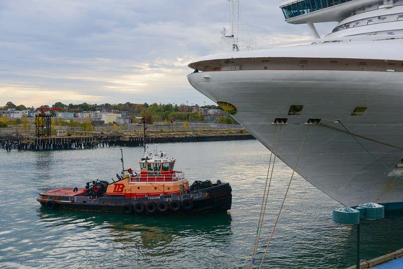 The tug Freedom with the Caribbean Princess in the Reserved channel in Boston Harbor.