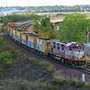 An MBTA ballast train heads to Everett Jct to load.