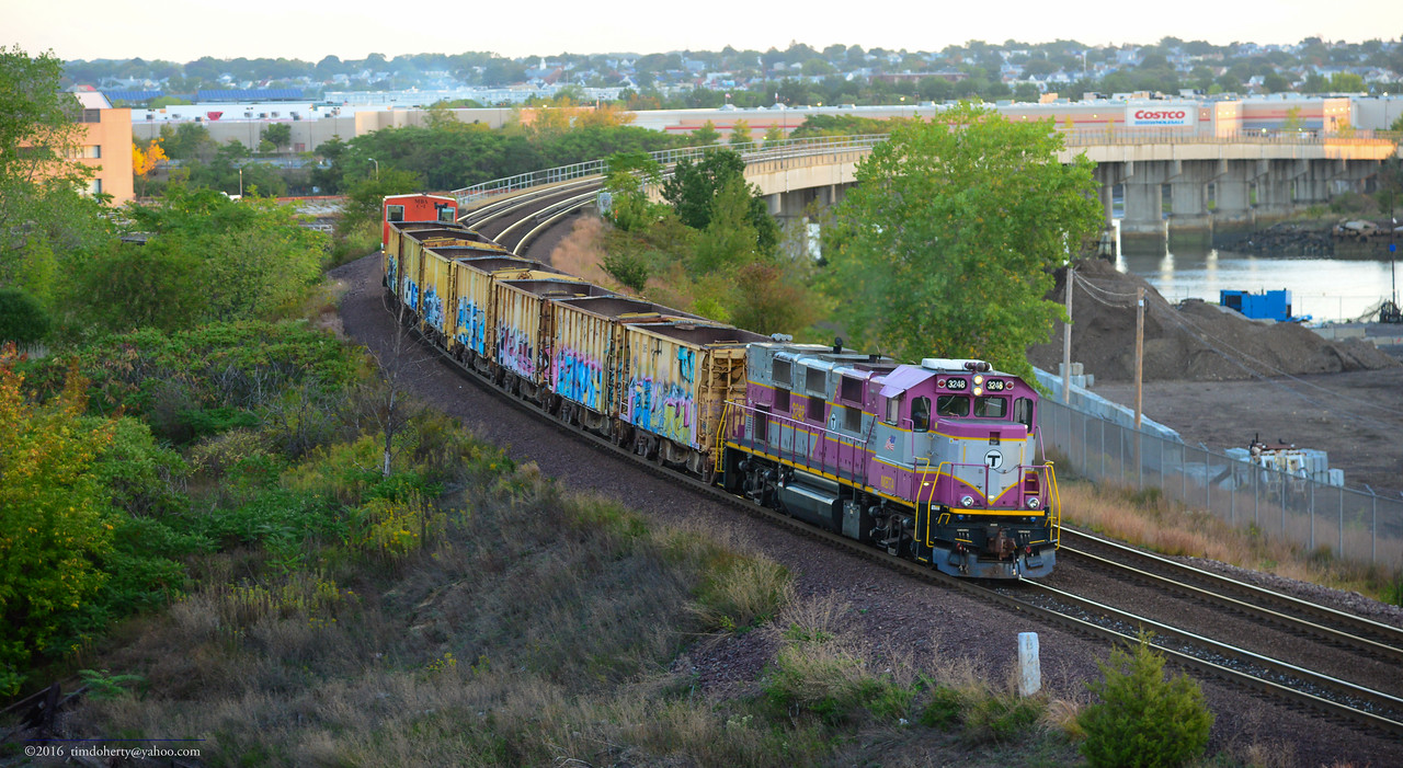 An MBTA ballast train heads to Everett Jct to load.
