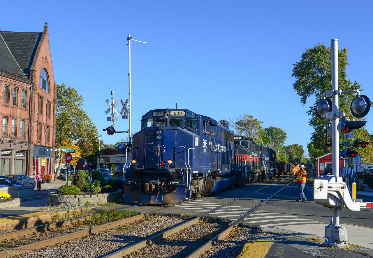 Pan Am's SALO (Salem to Lowell) passes Cross Street in West Medford and one of the three remaining crossing tenders in Massachusetts. My Dad grew up a few blocks from here and he and I watched commuter trains one summer night in 1984.