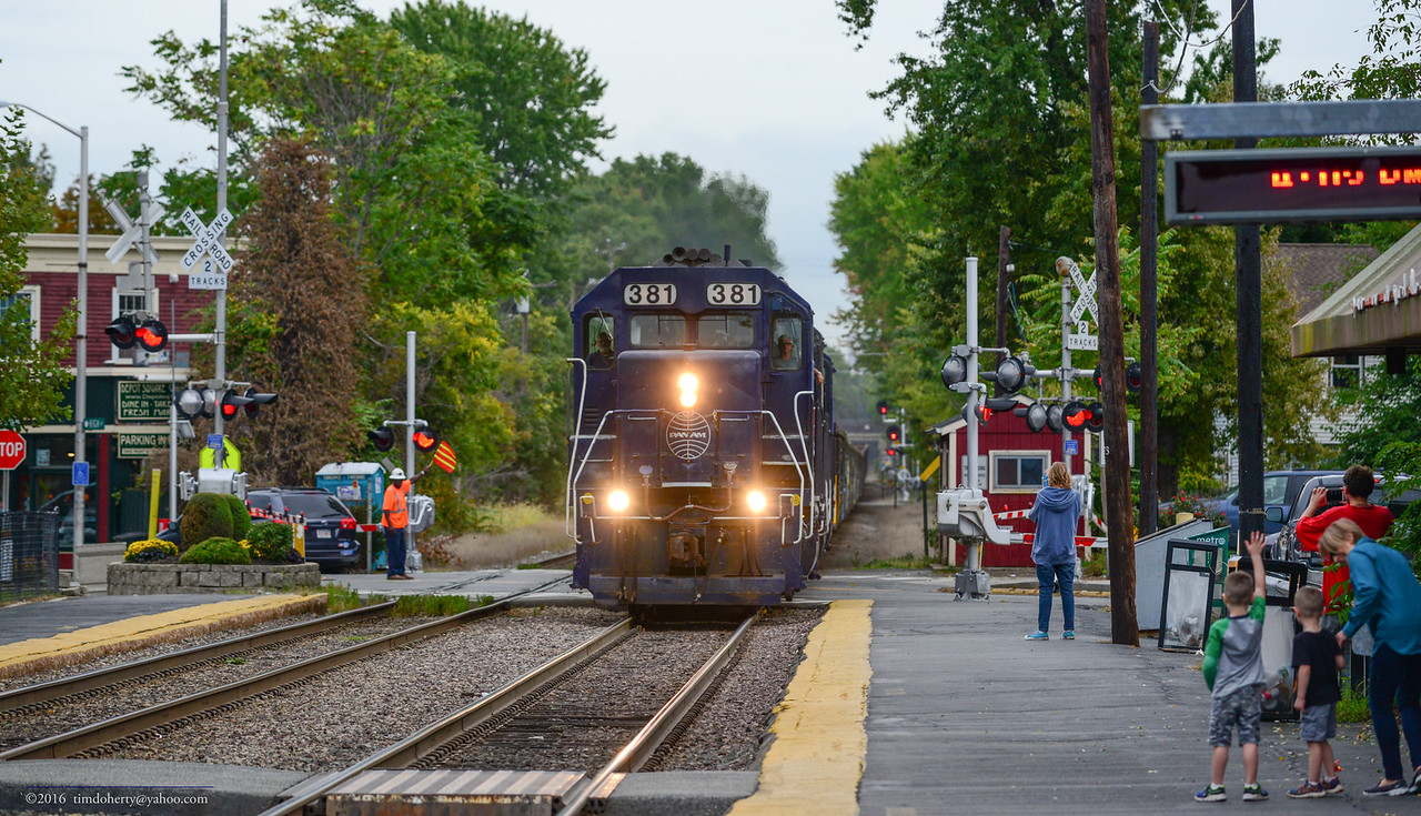 A daylight freight on the Lowell Line as Pan Am's SALO passes through West Medford.