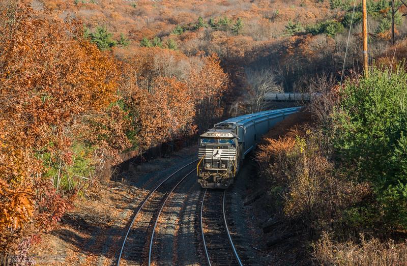NS 6907 pushes a loaded grain train at Athol.