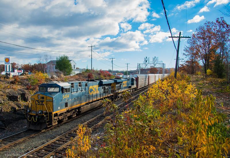 A pair of CSX GEs pass through CPF 345 before working Gardner Yard with a westbound autorack train.
