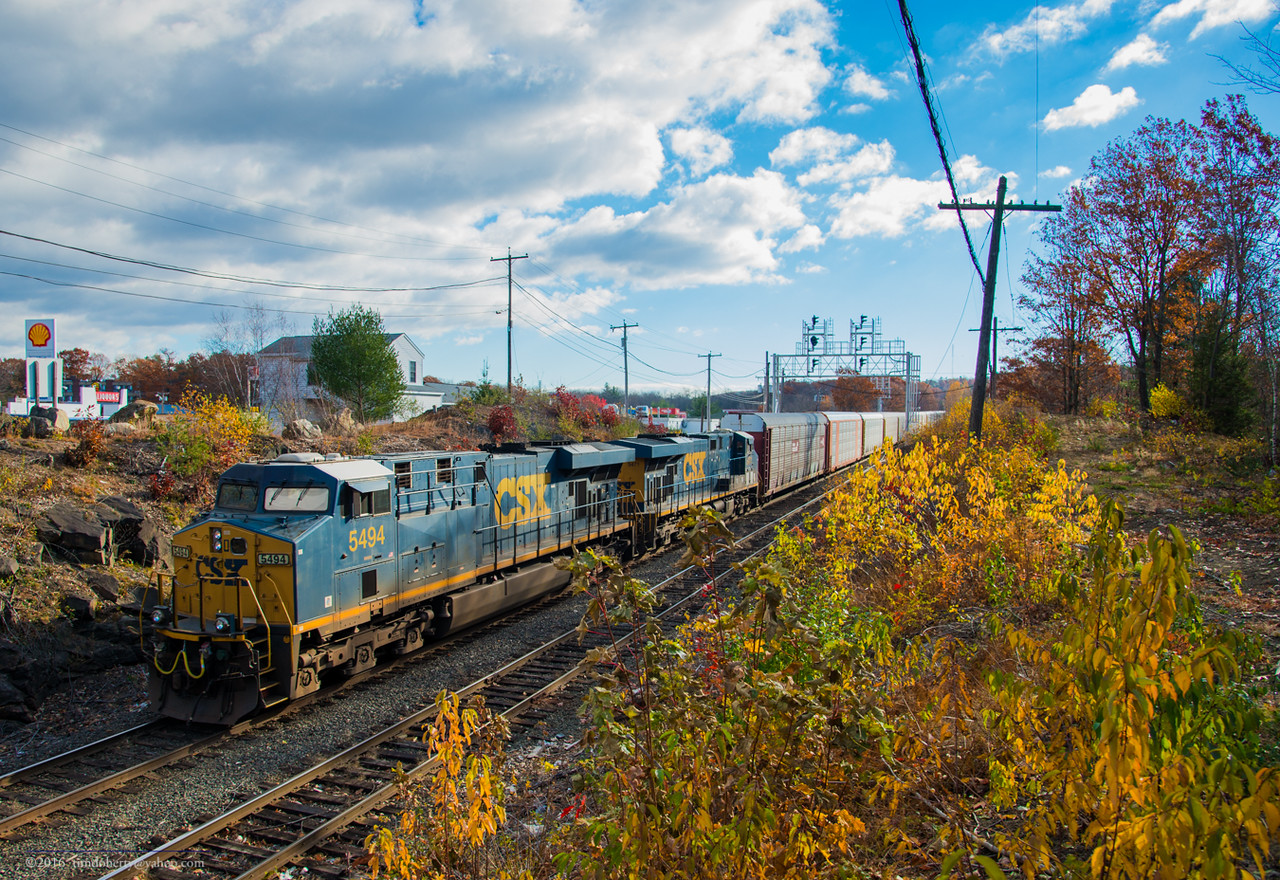 A pair of CSX GEs pass through CPF 345 before working Gardner Yard with a westbound autorack train.