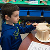 JOED VIERA/STAFF PHOTOGRAPHER-Lockport, NY-First grader Noah Corraine demostrates the use of mortar (Play-Doh) on his wooden house model in the Maker Space at Roy B. Kelley Elementary School