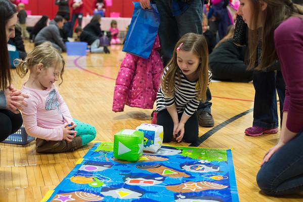 JOED VIERA/STAFF PHOTOGRAPHER- Pendleton, NY-Sheena(3) and Ramona(5) Galvin play a game during math night.