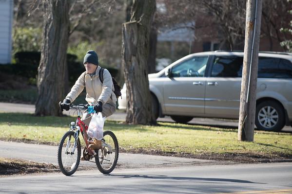JOED VIERA/STAFF PHOTOGRAPHER-Lockport, NY-A man rides his bike down Lincoln Avenue.