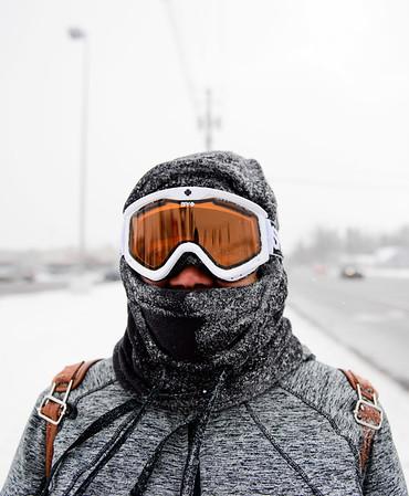 JOED VIERA/STAFF PHOTOGRAPHER-Lockport, NY-A bundled up Loroli Blackwood walks to work along Transit Road.