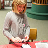 JOED VIERA/STAFF PHOTOGRAPHER-Lockport, NY- Hayleigh Brewer 8 works on crafting penguins at the Lockport Public Library.