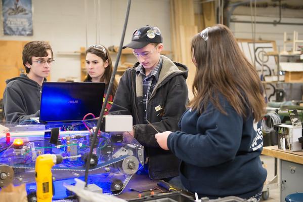 JOED VIERA/STAFF PHOTOGRAPHER- Newfane, NY-Newfane High School robotics team members Kyle Krause, Tyler Arnett, Lauren Seymour and Maggie McKenzie work on thier robot.