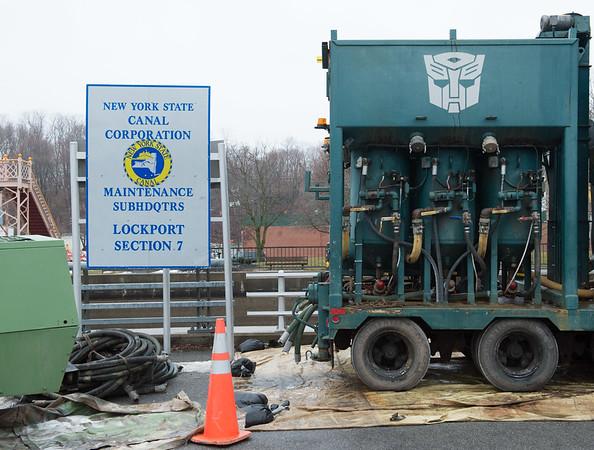 JOED VIERA/STAFF PHOTOGRAPHER- Lockport, NY-Equipment lies by the Exchange Street Bridge.