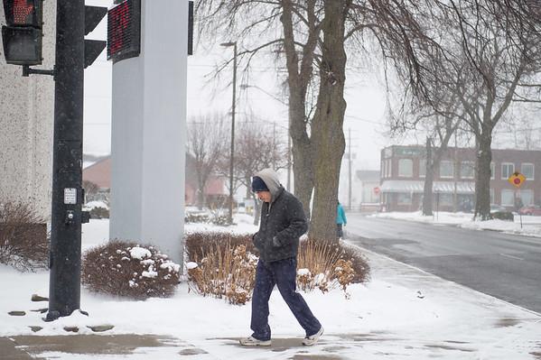 JOED VIERA/STAFF PHOTOGRAPHER-Lockport, NY-A man takes a cold and snowy walk on Main Street.