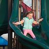JOED VIERA/STAFF PHOTOGRAPHER- Lockport, NY-Ava Drabinski 3 takes a ride down the slide at Day Road Park.