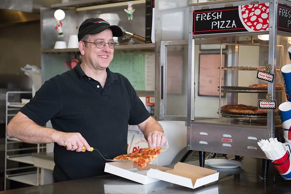 JOED VIERA/STAFF PHOTOGRAPHER-Wrights Corners, NY-Owner Darryl Blumrick packs up  a slice of pizza at Crossroads Pizzeria.