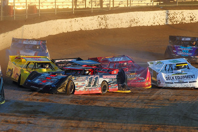 Tommy Bailey (11) spins on the backstretch