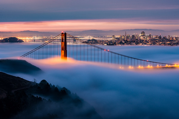 I love it when the fog just sits at the deck of the bridge, with most of the towers sticking out and the colorful span of the bridge dissecting through the fog. The city peaks out in the background and you can't help but enjoy the sunrise!