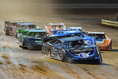 Scott Bloomquist (0) leading a heat race into turn one