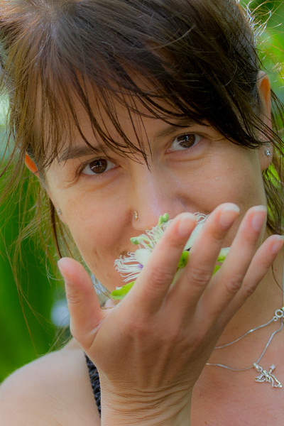 What a beautiful flower. the thing in her hand is cool too.