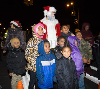 Children greet Santa Claus as the City of Newburgh welcomed its Broadway tree during its official dedication and tree lighting ceremony on Wednesday, December 14, 2016. Hudson Valley Press/CHUCK STEWART, JR.