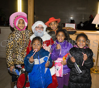 Children enjoy gifts and Candy Canes from Santa Claus as the City of Newburgh welcomed its Broadway tree during its official dedication and tree lighting ceremony on Wednesday, December 14, 2016. Hudson Valley Press/CHUCK STEWART, JR.