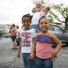 Young children lined the route for the City of Newburgh hosted Memorial Day Parade on Monday, May 30, 2016, which proceeded along Broadway to Washington's Headquarters. Hudson Valley Press/CHUCK STEWART, JR.