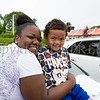 Kasi Smith, 4-years-old, with his mom Asia Woody, enjoing the City of Newburgh hosted Memorial Day Parade on Monday, May 30, 2016, which proceeded along Broadway to Washington's Headquarters. Hudson Valley Press/CHUCK STEWART, JR.