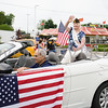 Parade Grand Marshal Karen Knappy waves to the crowds during the City of Newburgh hosted Memorial Day Parade on Monday, May 30, 2016, which proceeded along Broadway to Washington's Headquarters. Hudson Valley Press/CHUCK STEWART, JR.