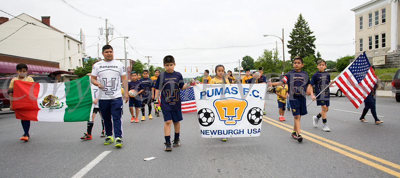 Pumas Soccer Club marched in the City of Newburgh hosted Memorial Day Parade on Monday, May 30, 2016, which proceeded along Broadway to Washington's Headquarters. Hudson Valley Press/CHUCK STEWART, JR.