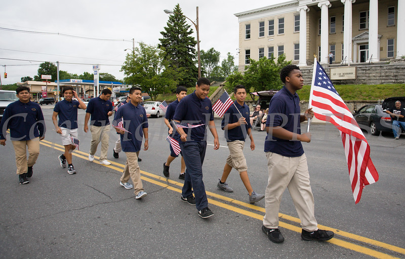 Students from the San Miguel Academy marched in the City of Newburgh hosted Memorial Day Parade on Monday, May 30, 2016, which proceeded along Broadway to Washington's Headquarters. Hudson Valley Press/CHUCK STEWART, JR.
