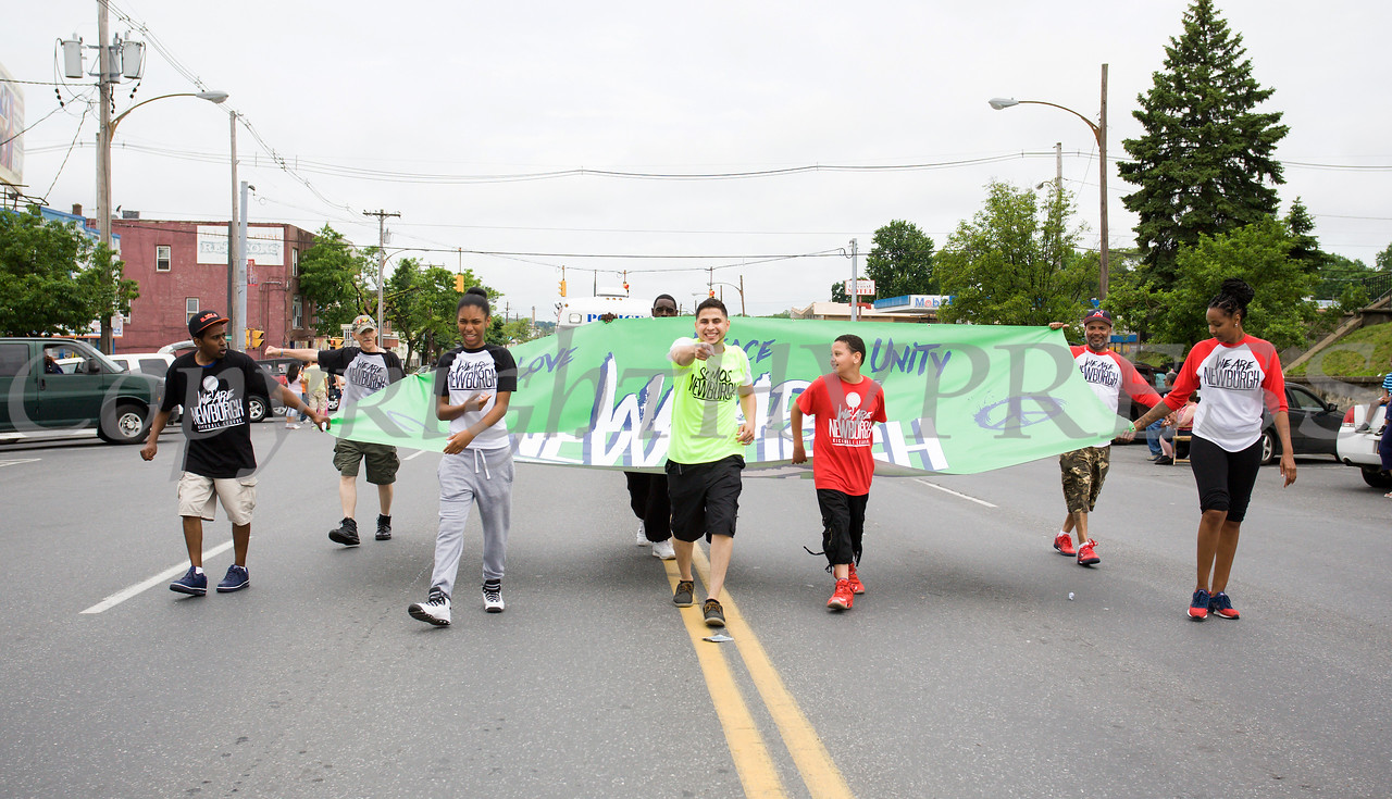 Members of the group We Are Newburgh marched in the City of Newburgh hosted Memorial Day Parade on Monday, May 30, 2016, which proceeded along Broadway to Washington's Headquarters. Hudson Valley Press/CHUCK STEWART, JR.