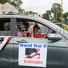A Wold War II veteran waves from a car duirng the City of Newburgh hosted Memorial Day Parade on Monday, May 30, 2016, which proceeded along Broadway to Washington's Headquarters. Hudson Valley Press/CHUCK STEWART, JR.