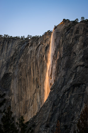I zoomed out a bit, to 150mm, to show the entire scene. Here you see Horsetail Falls, lit up as Fire Falls!