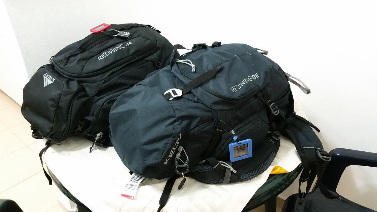 Craig's Kelty Redwing 44 (l) and Yael's Kelty Women's Redwing 40.  These bags fit in the overhead compartments of all seven flights during our trip, eliminating the need to check bags.