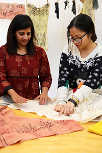 Penny Xiong (Art History) discusses her final project (seen here) with Meeta.