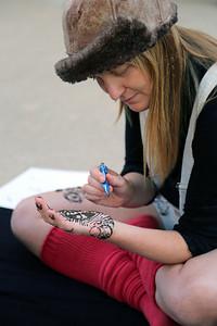 Emily Popp (MFA, Design Studies) finishing her henna design.