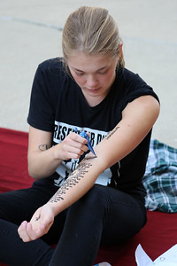 """Lucy Hodkiewicz (Art) used henna dye to discuss """"the apologetic script that women often follow"""""""
